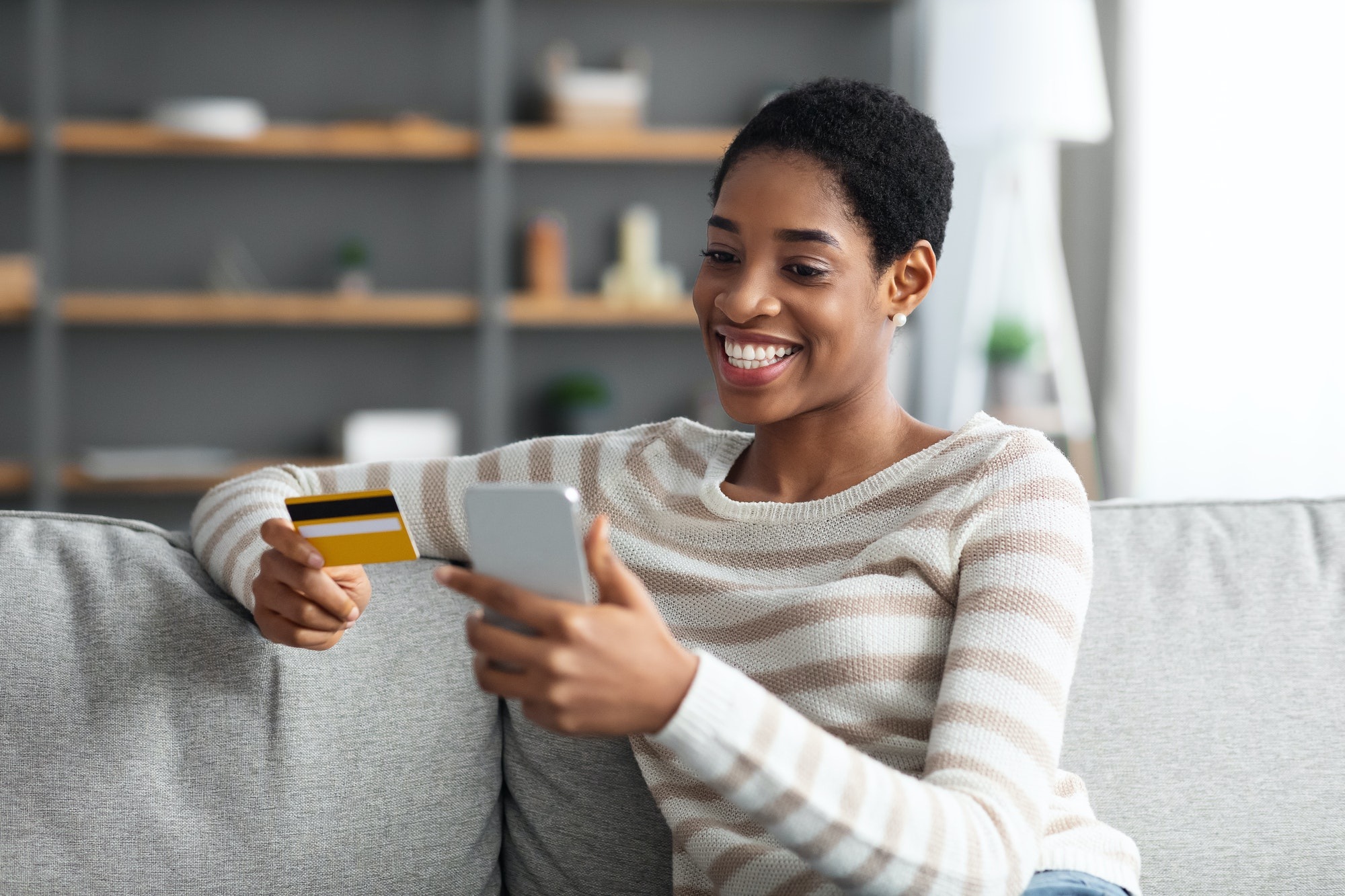 Fast Money Transfers. Smiling Black Female With Smartphone And Credit Card